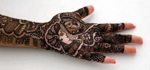 Black traditional mehndi design with bride and groom art