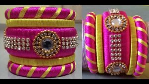 Pink and yellow thread bangles