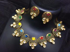 Stylish stone studed gold necklace