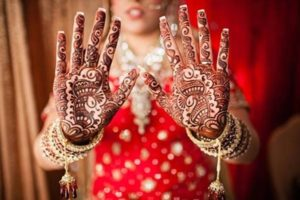 Bridal palm red mehendi design