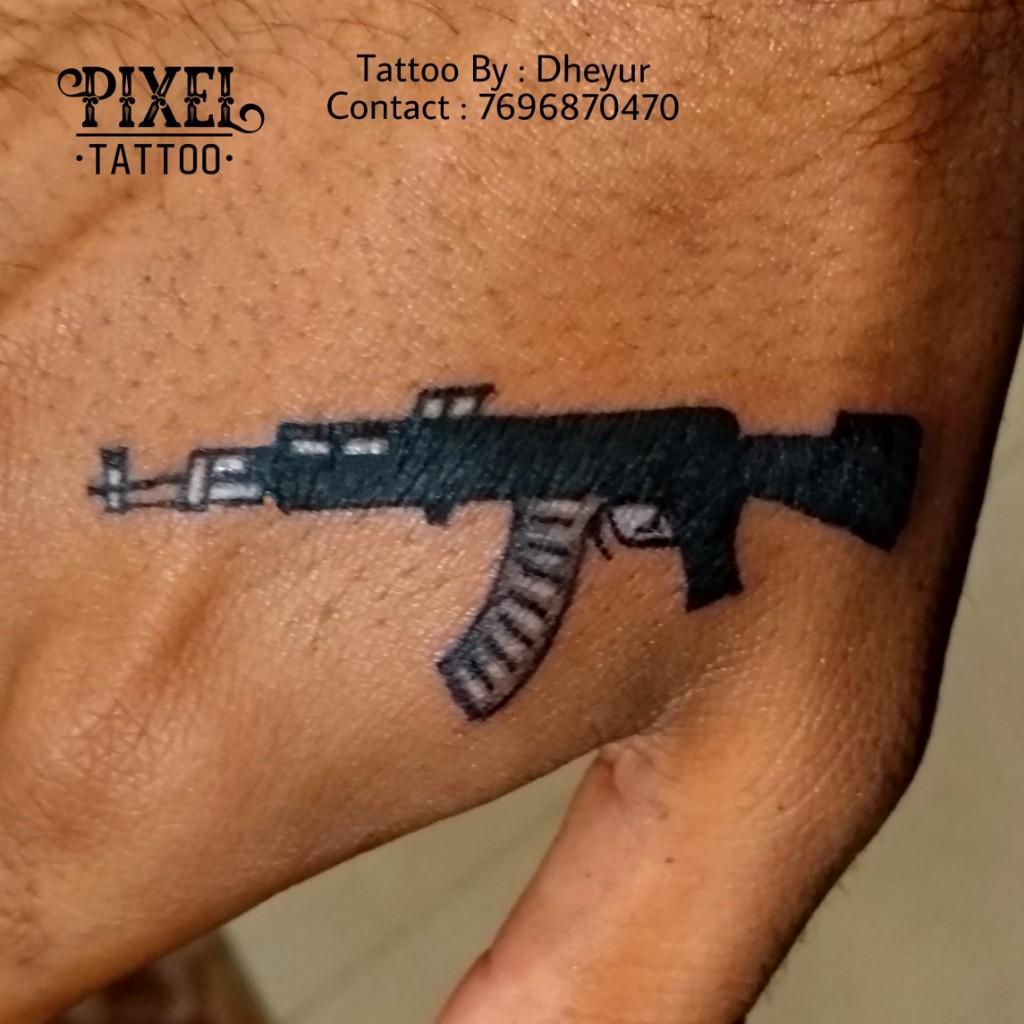Gun-Tattoo